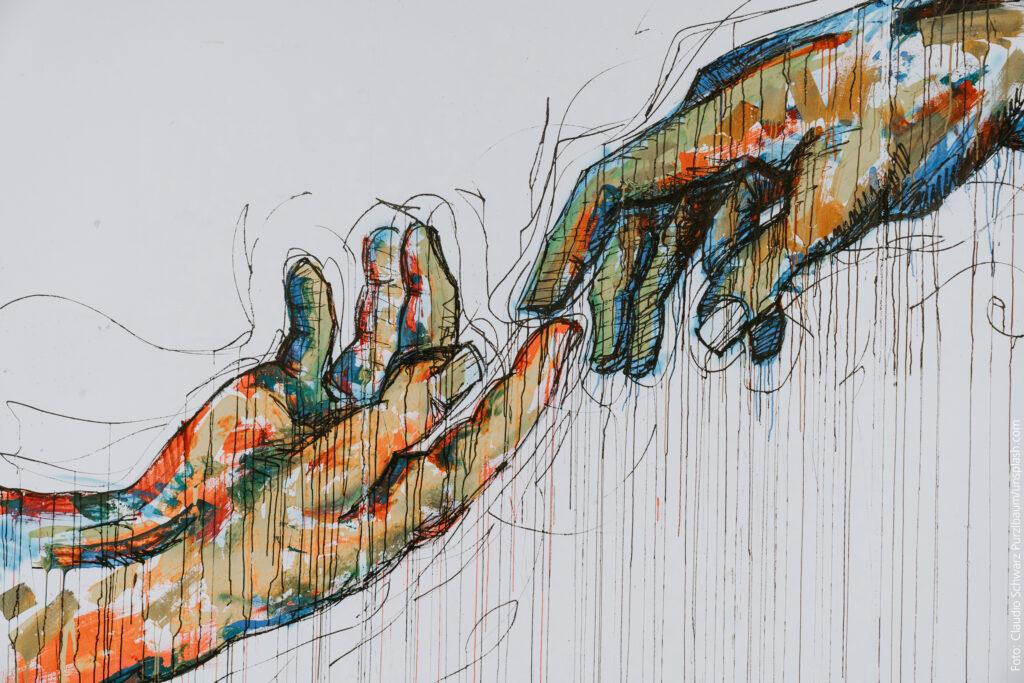 Graffiti: zwei Hände berühren sich fast - frei nach Michelangelo